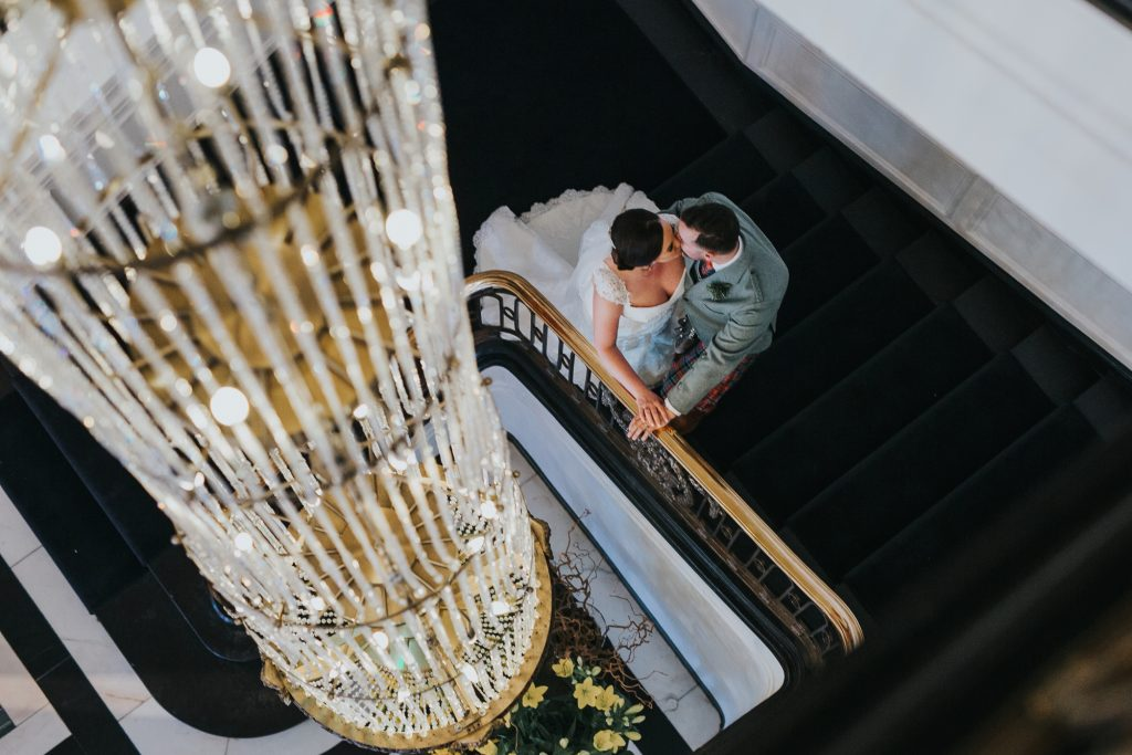 Natural wedding photography Edinburgh couple on staircase